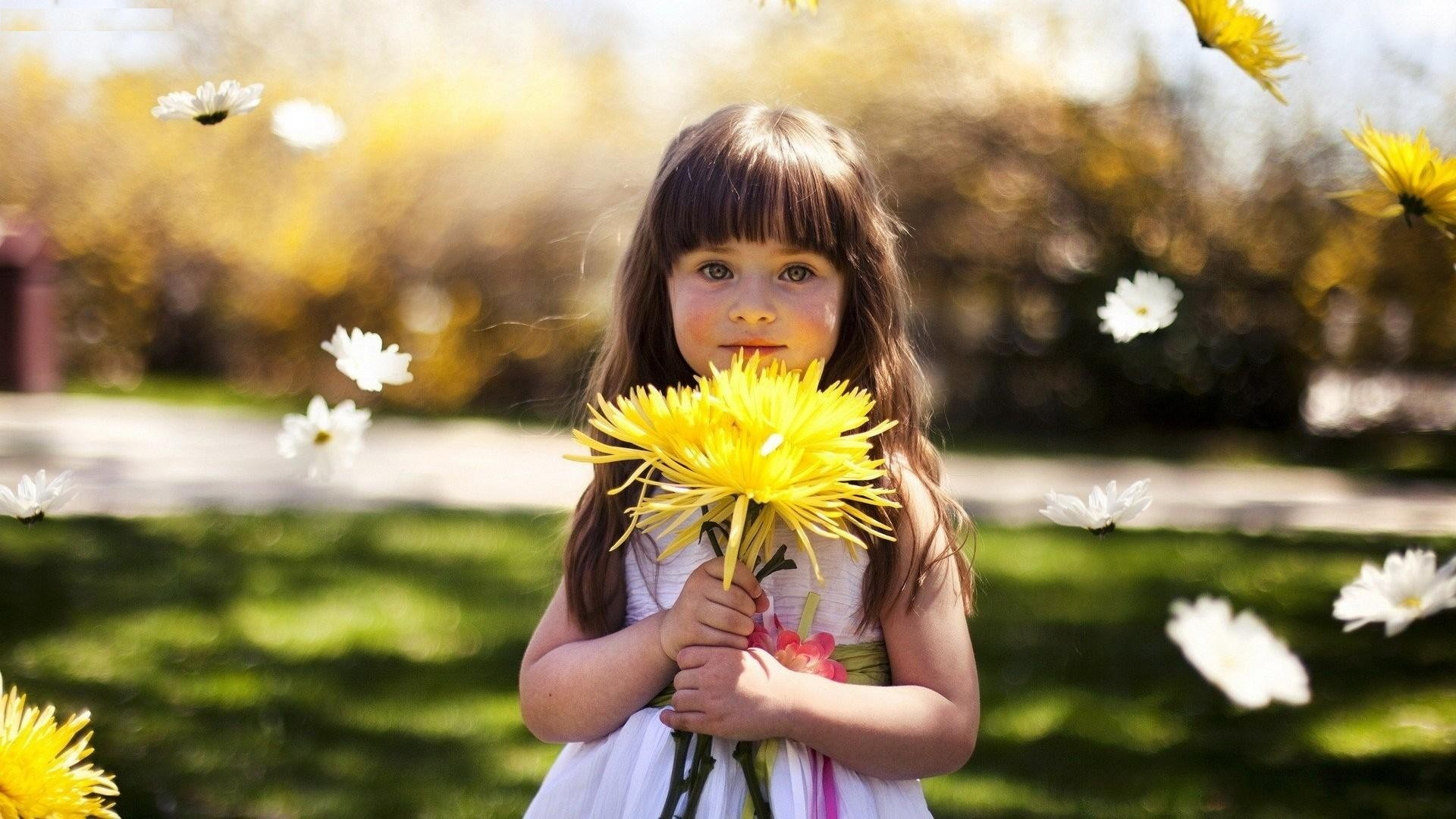 Lovely Beauty Baby Girl Having Yellow Sunflower